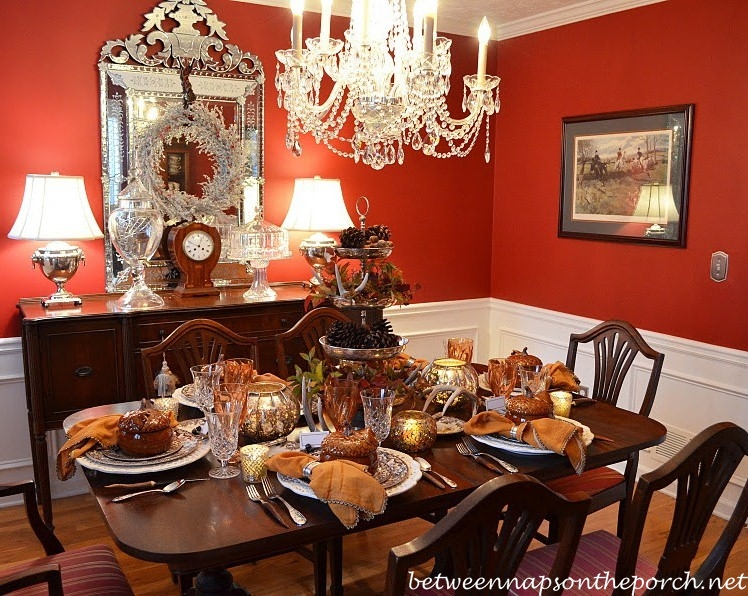 Beeswax candle covers and satin wrapped bulbs for chandeliers for Thanksgiving dining room decorating ideas