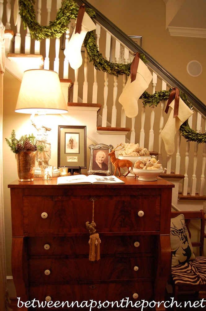 Banister Decorated with Preserved Boxwood Garland and Stockings