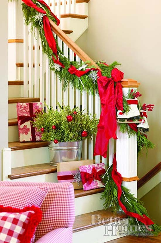 banister decorated with garland ice skates and red ribbon - Decorating Banisters For Christmas With Ribbon
