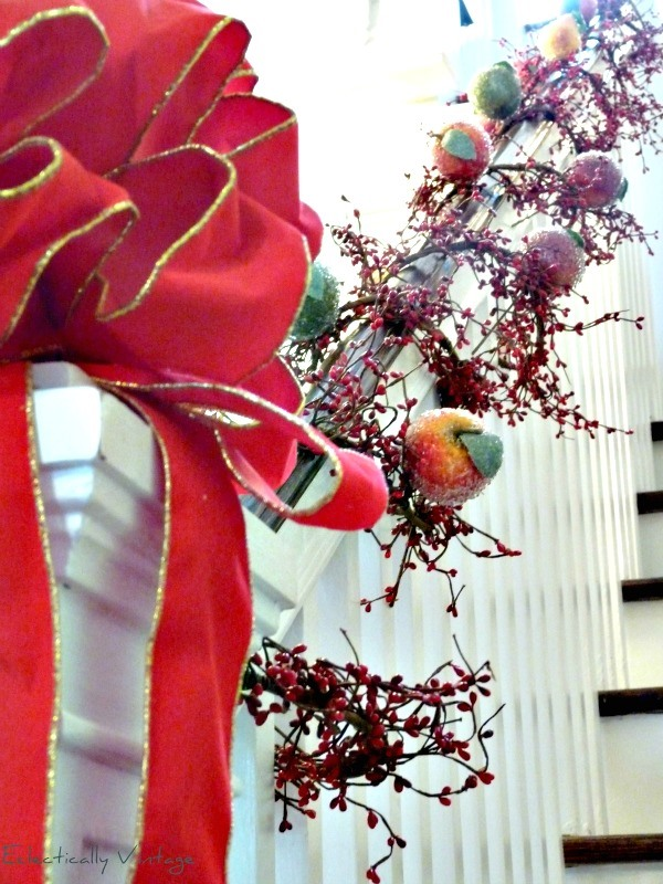 Christmas Banister Decorated with Berry Garland