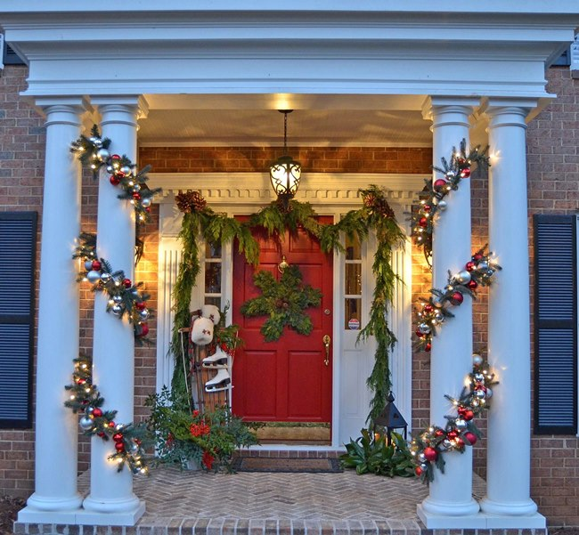Christmas-Porch-with-Snowflake-Wreath-and-Lit-Garland