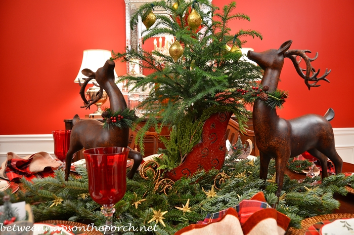 Christmas Table Setting Tablescape with a Deer and Sleigh Centerpiece