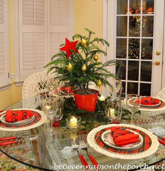 Christmas Table Setting with a Christmas Tree Napkin Fold