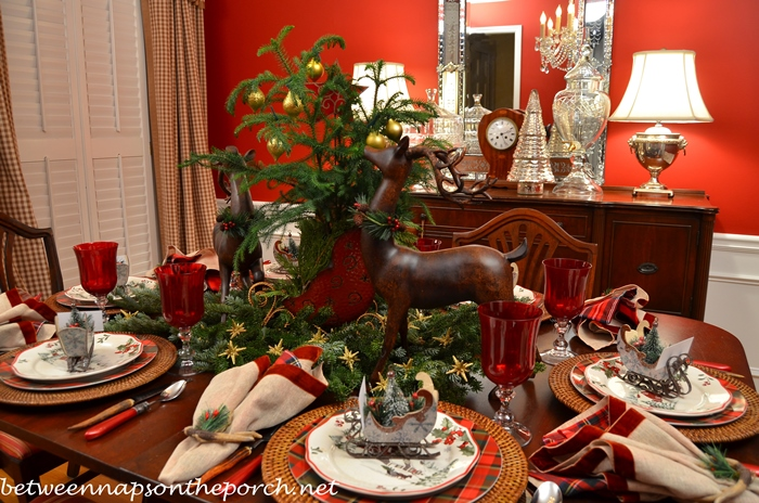 Christmas Tablescape Table Setting with Plaid Plates and Deer Centerpiece