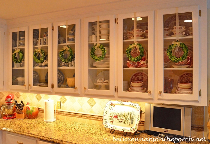 Decorate Kitchen Cabinets With Preserved Boxwood Wreaths