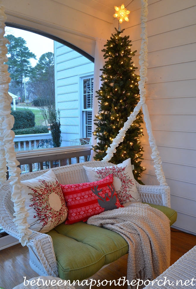 Porch Swing with Christmas Pillows