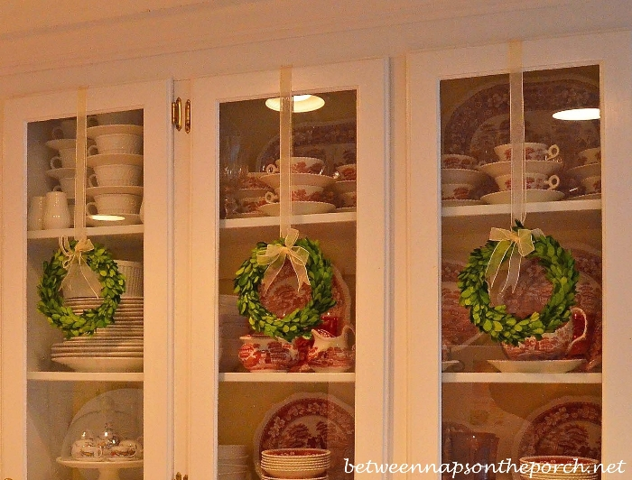 preserved boxwood wreaths on kitchen cabinets