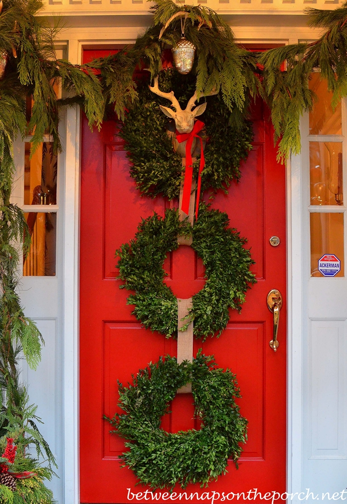 Christmas front porch with three 3 boxwood wreaths deer for 3 wreath door decoration