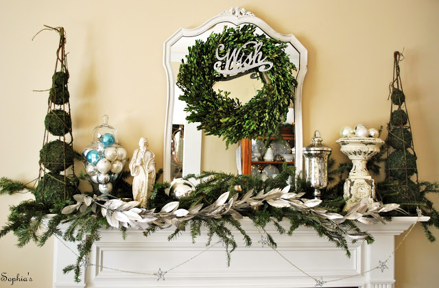 Silver and White Christmas Mantel with Natural and Preserved Greenery