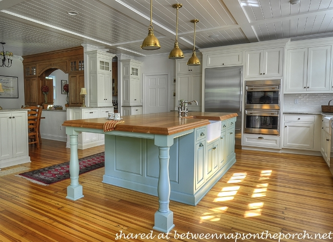 Kitchen with Large Butcher Block Island and White Painted Cabinets