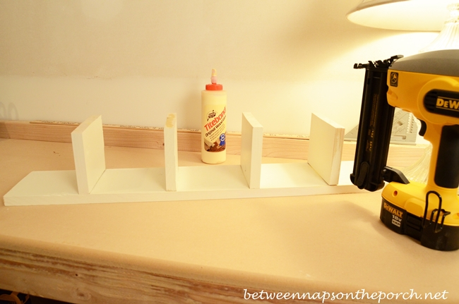 Gluing and Nailing Walls of Pottery Barn Inspired Cubby Organizer_wm