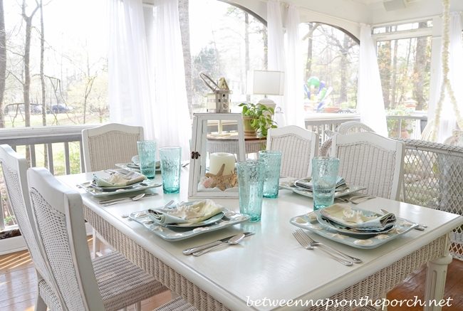 Beach Table Setting With Lighthouse Lantern Centerpiece Between Naps On The Porch