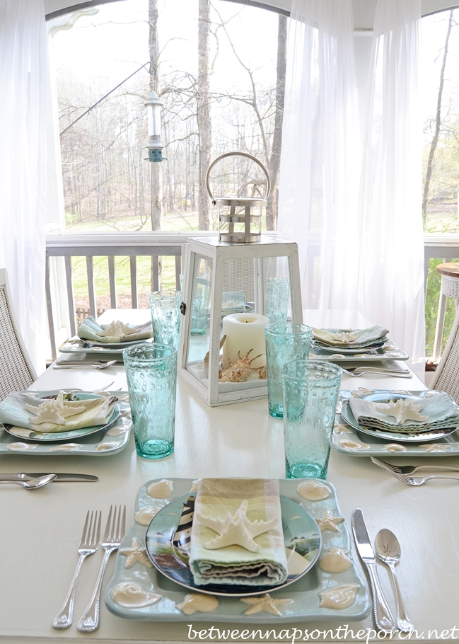 Beach themed table setting tablescape with lighthouse