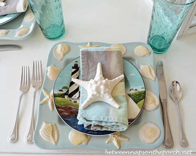 Beach Table Setting with Shell and Sailboat Plates