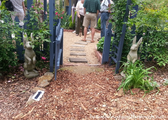 Bunnies Framing Arbor Entrance To Garden_wm