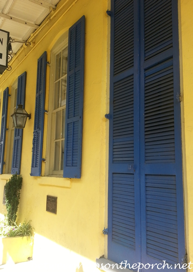 New Orleans French Quarter With Wrought Iron Balconies & Colorful Shutters 17