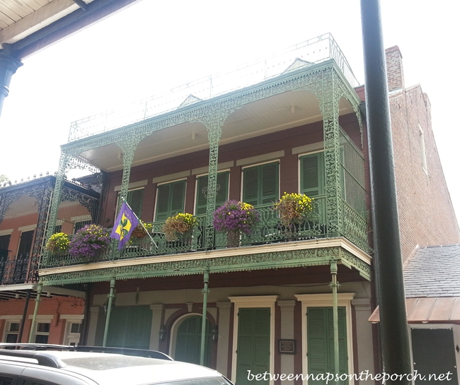 New Orleans French Quarter With Wrought Iron Balconies & Colorful Shutters 19