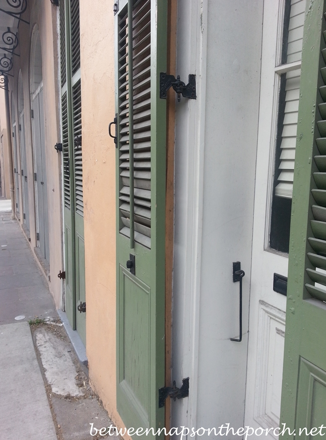 New Orleans French Quarter With Wrought Iron Balconies & Colorful Shutters 21