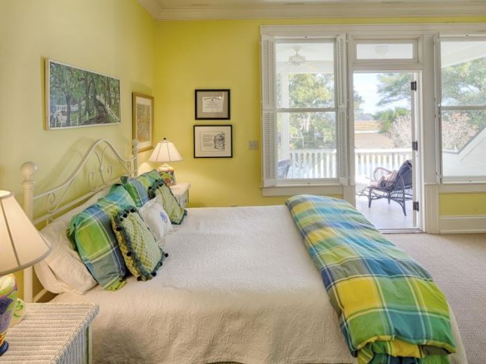 BedRoom in Yellow with a Balcony Porch