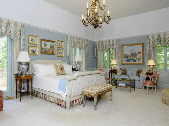 Elegant Blue Bedroom with Upholstered Bed in Khakum Woods 1929 Estate