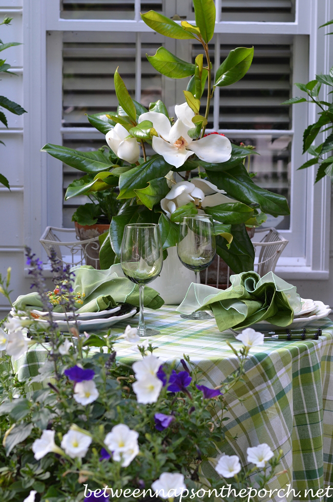 Magnolia Branch Centerpiece : Romantic summer table setting with moonlight and magnolias