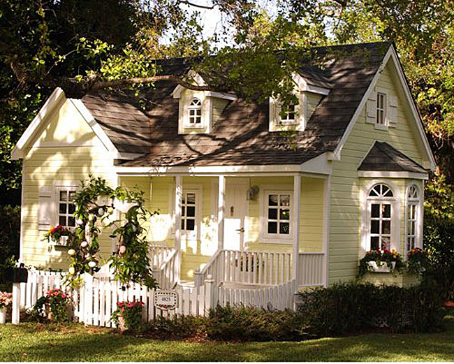 Yellow Dream Cottage With White Picket Fence