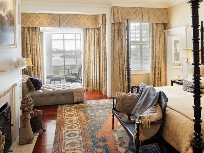Bedroom with Spool Bed, Lake View and Antique Rug