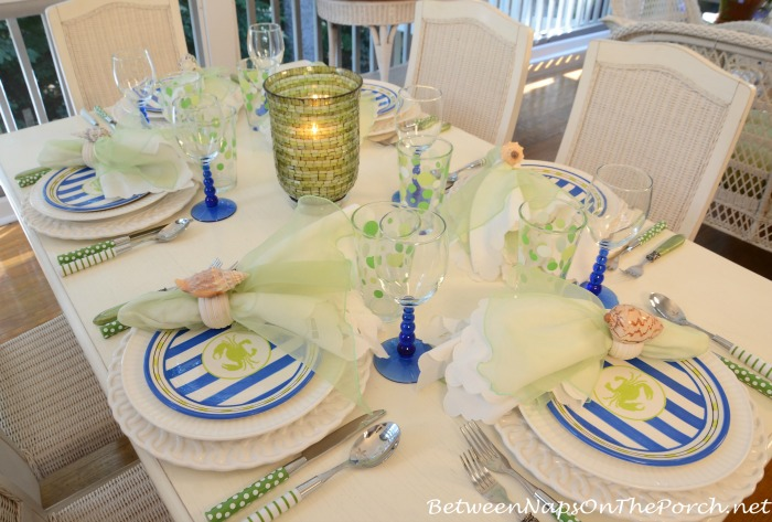 A Summer Porch With A Beach Themed Table Setting Tablescape
