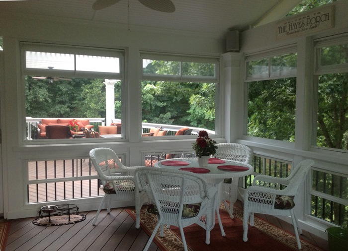 Wicker Table & Chairs On Screened Porch