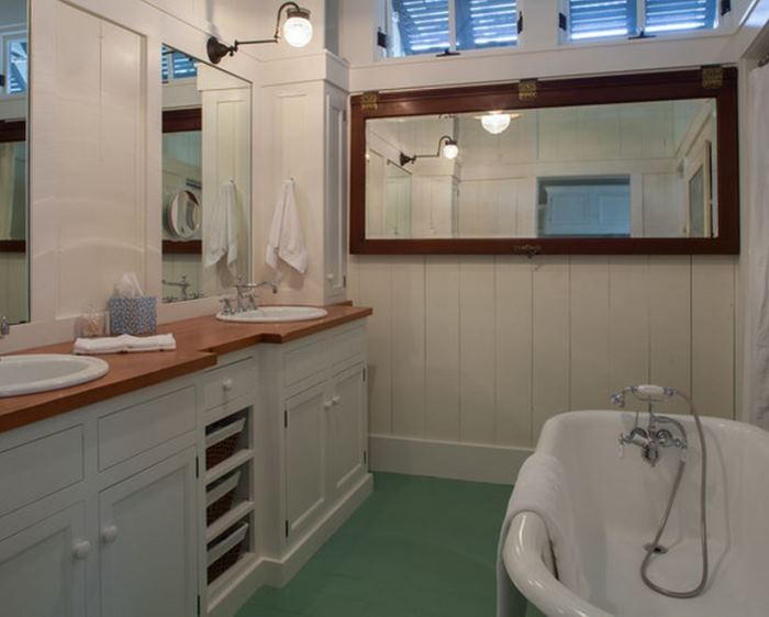 Cottage Bath with Painted White Cabinetry and Wood Countertop