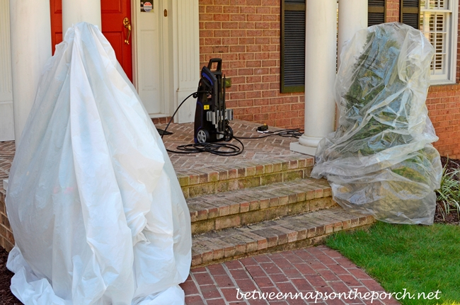 Covering Boxwoods for Pressure Washing Porch_wm
