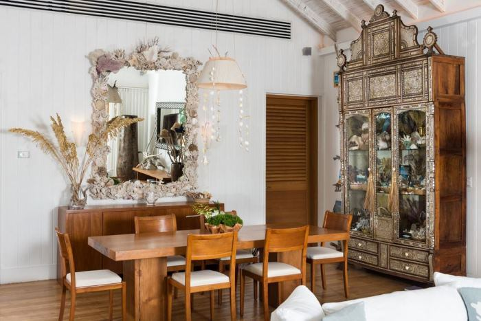 Christie Brinkley's Beach House  Dining Room With Venetian Glass Cabinet & Shell Mirror
