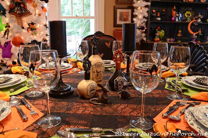 Halloween Table Setting With Poison Bottle Centerpiece
