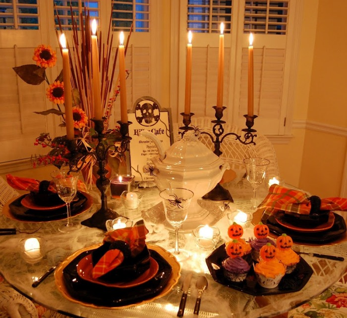 Lit Halloween Table Setting With Spiderweb Tablecloth