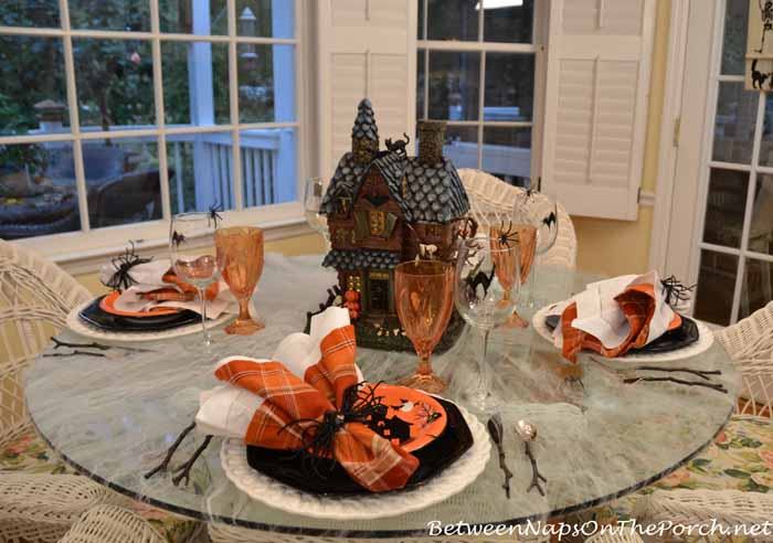 Halloween Table Setting with a Cobweb Tablecloth