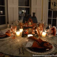Halloween Tablescape With Haunted House Centerpiece & Spiderweb Tablecloth