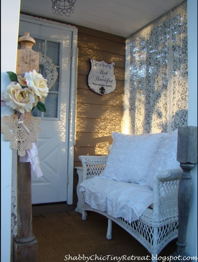 A Sweet Cottage Porch With White Wicker