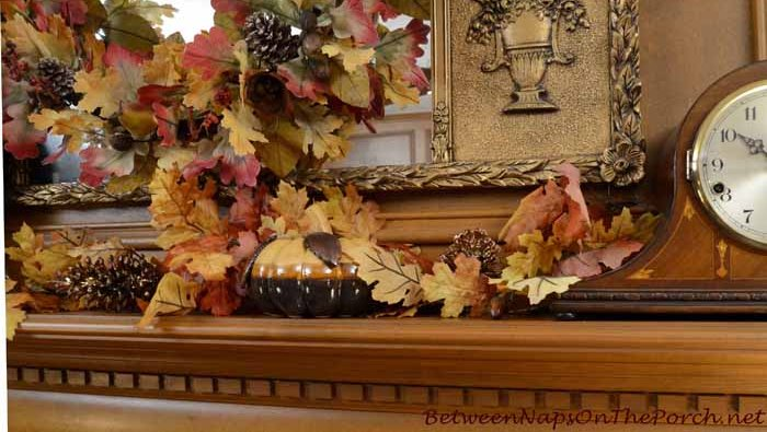Fall Thanksgiving Mantel Decorated with Fall Leaves and Pumpkins