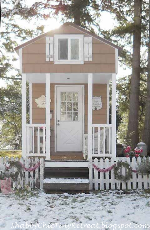 White Picket Fence Decorated with Wreaths and Garland for a Cottage Home