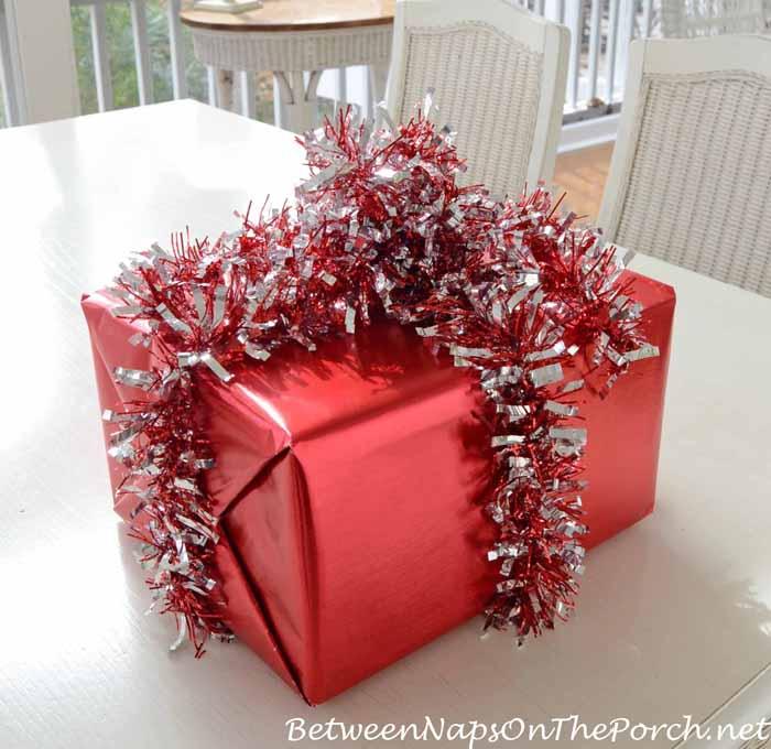Wrap Present In Garland