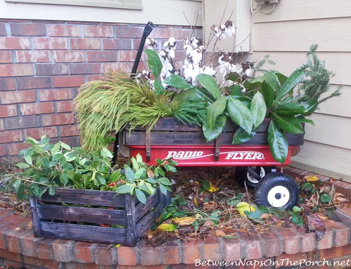 Christmas Wagon Filled With Greenery_wm