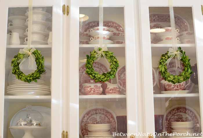 Preserved Boxwood Wreaths Decorate Kitchen Cabinets