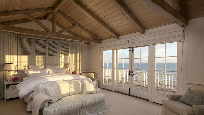 Shutter Wall Behind Bed in Beach House