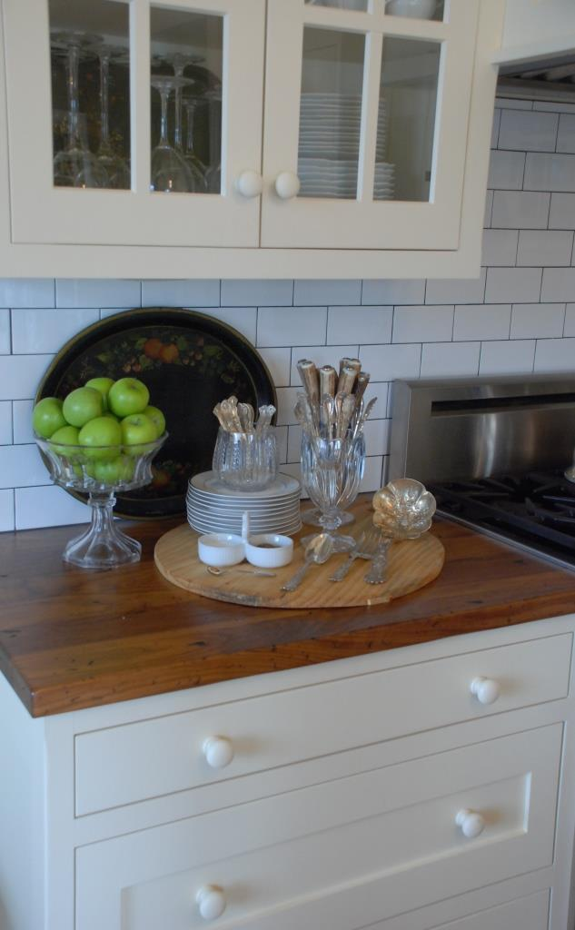 Mary Carol Garrity's Cottage Kitchen With Wood Countertops and Subway Tile