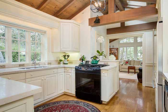 Cottage Kitchen with Open Bean Ceiling