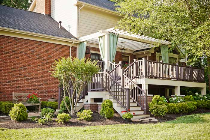 Deck Addition With Outdoor Curtains and Pergola