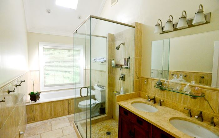 Bath renovation, travertine marble tiles, glass shower