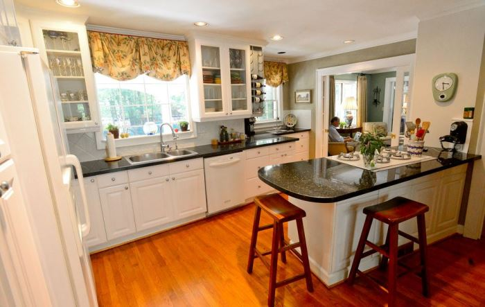 Kitchen Renovation with White Cabinets and Dark Green Marble