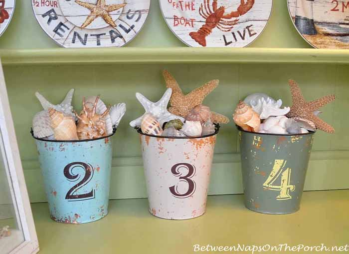 Numbered Pails Filled With Shells