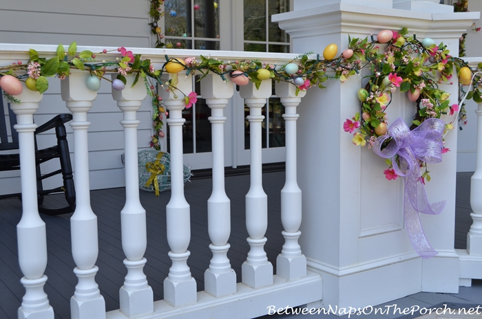 Porch Rail Decorated with Spring Egg Garland